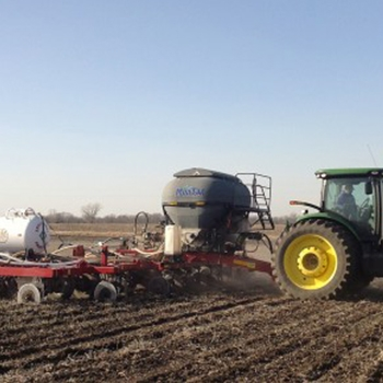 Custom application of Anhydrous Ammonia and dry fertilizer in the same pass.
